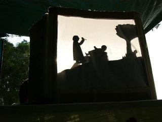 shadow puppet show at sunset